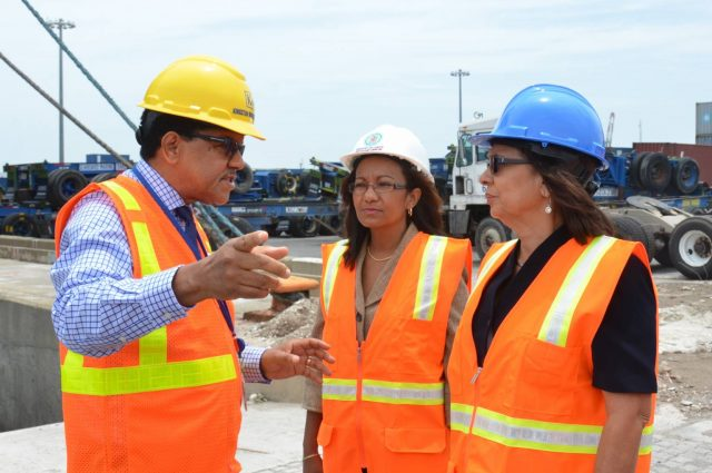 Minister of Labour and Social Security, Hon. Shahine Robinson (right), listens as Chief Executive Officer of Kingston Wharves Limited, Grantley Stephenson, outlines the operations of the entity, during a tour of Port Bustamante on Wednesday (May 25). At left is Permanent Secretary in the Ministry, Colette Roberts Risden.